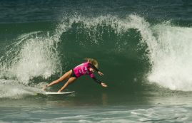Laura Enever launching off her board