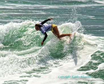 Carissa Moore showing her surfing style and grace.