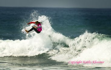Courtney Conlogue getting air on a wave in Oceanside, CA.
