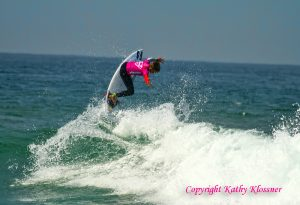 Courtney Conlogue getting air off a wave
