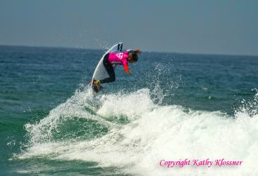 Courtney Conlogue getting some air at a surf contest.