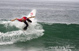 Stephanie off the lip at a surf contest.