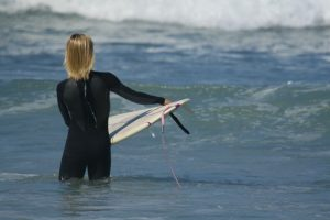A young girl checks out the surf conditions