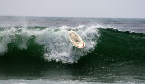 A loose surfboard in the waves