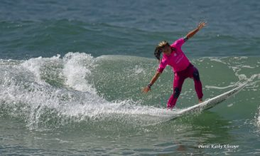 Courtney Conlogue doing a wave hop at Trestles, CA 2017