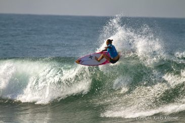 Carissa Moore rockets off a wave.